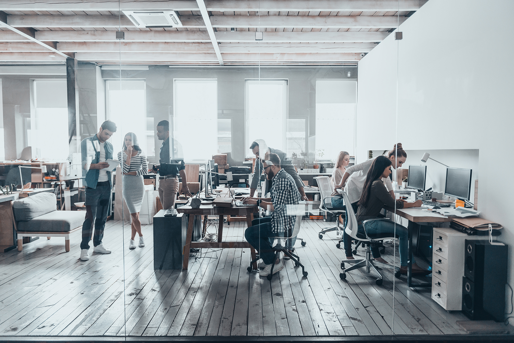 Open concept office at an IT company with a team of young professionals
